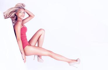 Sensual blonde woman posing in studio