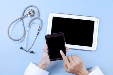 Doctor working with smartphone