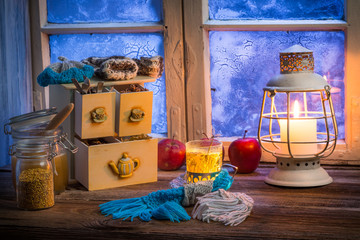 Warming tea in a winter cottage