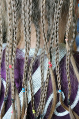 girl's plaits on the fabric pattern of the suit