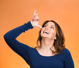Woman, gesturing with hand thumb to go party, get drunk