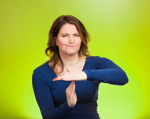 Serious woman showing timeout gesture with hands