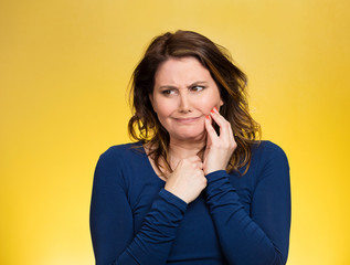 Portrait Woman with sensitive tooth ache on yellow background