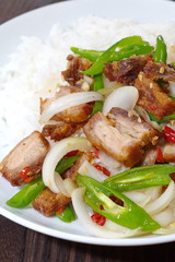 Fried sweet pepper and onion with roasted pork
