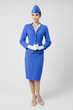 Charming Stewardess Dressed In Blue Uniform - 69555069