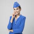 Leinwanddruck Bild - Charming Stewardess Dressed In Blue Uniform