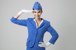 canvas print picture - Charming Stewardess Dressed In Blue Uniform