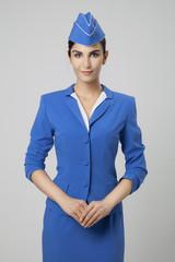 Charming Stewardess Dressed In Blue Uniform