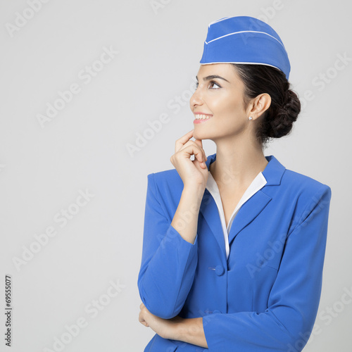 Charming Stewardess Dressed In Blue Uniform - 69555077