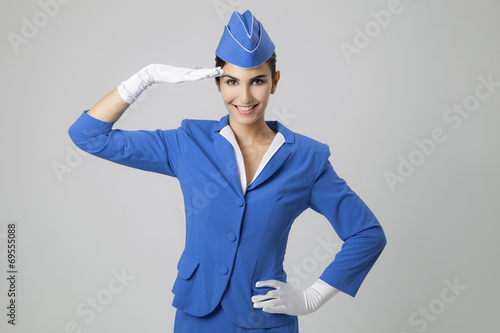Charming Stewardess Dressed In Blue Uniform - 69555088