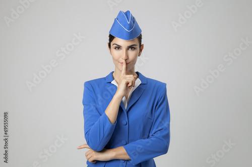 Charming Stewardess Dressed In Blue Uniform - 69555098
