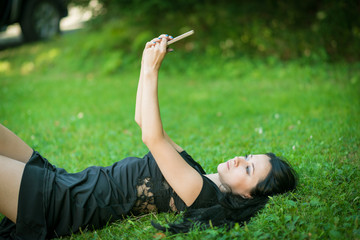 Young woman making selfie by her smartphone.