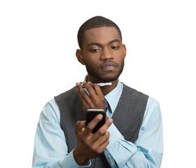 Man shaving reading news on smartphone, white background