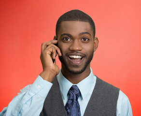 Happy business man, talking on mobile phone, red background