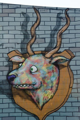 Ram mural graffiti on the textured wall