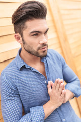 young casual man is praying
