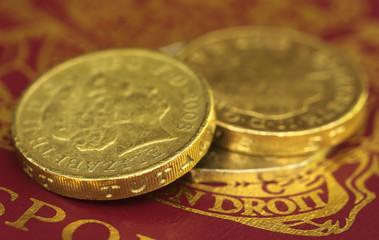 British Pound coin on passport