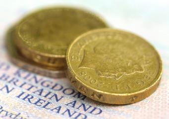 British Pound coin on a passport