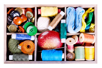 various threads and sewing tools in box