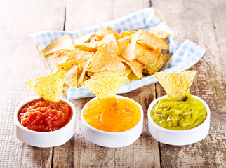 nachos with various sauces
