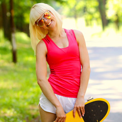young athletic girl rides sitting on a skateboard