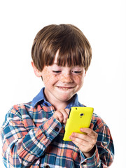 Red-haired funny boy with mobile phone