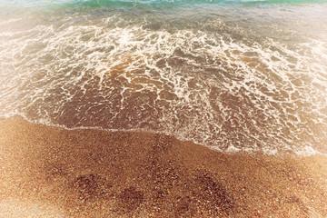 Wave sea and rocks on beach