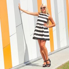 Portrait of trendy fashion girl in sunglasses