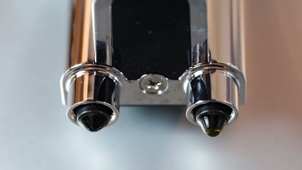 Bottom view of nozzles in coffee maker.