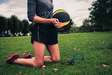 Woman with medicine ball and resistance band