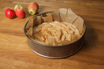 Unbaked apple pie on a table
