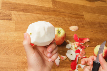 Showing a peeled apple
