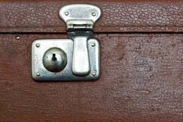 closed lock of an old suitcase dark brown color