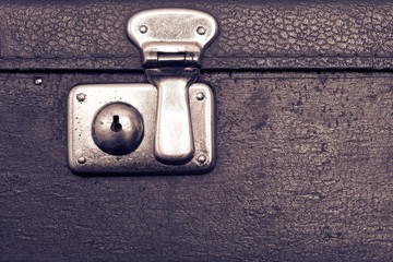 closed lock of an old suitcase dark violet color