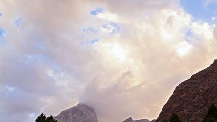 Peaks in the clouds at sunset. Pamir, Tajikistan. UltraHD (4K)