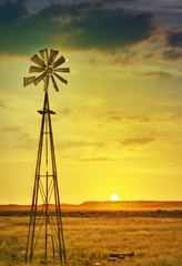 African farm land and windmill