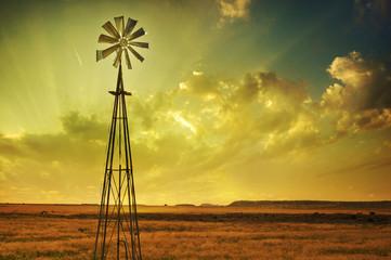 Windmill in African savannah farm land