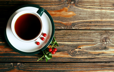 Cup of tea on a wooden background. Top view