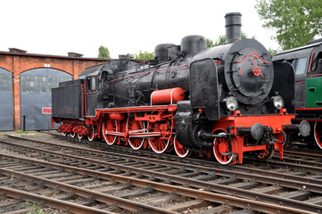 Old steam locomotive on railroad.