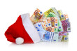 Euro banknotes coming out of Santa Claus hat on white background