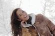 canvas print picture - Junge Frau im Schnee , lächelnd