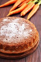 Homemade carrot cake on wooden table