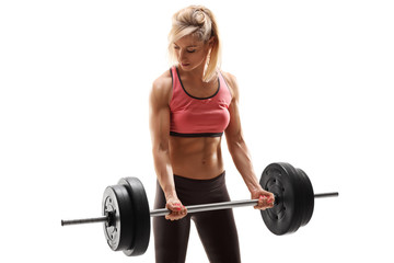 Attractive female athlete exercising with barbell