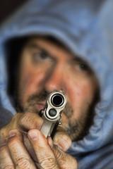 Thief or gang member holding a handgun
