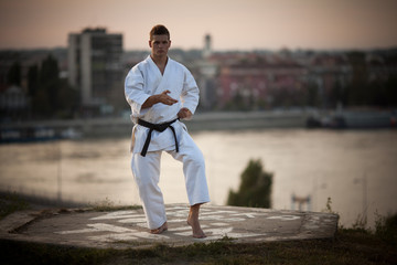 Man practicing martial arts outdoors