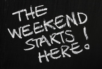 The weekend starts here! on a blackboard