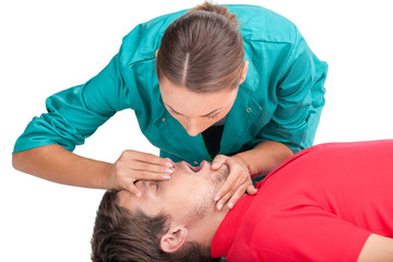 Young female giving patient CPR.