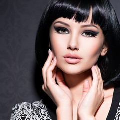 Beautiful woman with short black hair.