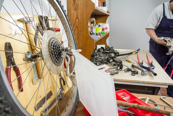 Wheel and bicycle parts over workshop table