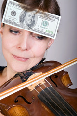 woman plays the viola with banknotes on forehead
